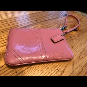 Pink patent leather Coach wristlet